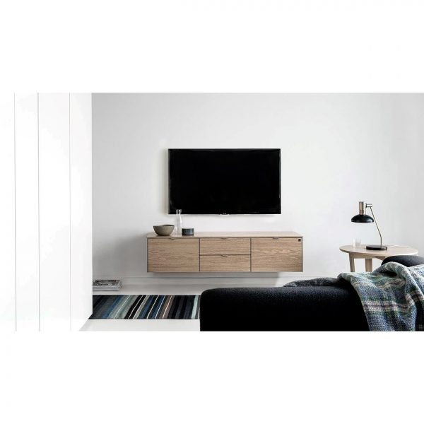 Skovby SM931 TV Unit in Oiled Walnut mounted to wall in Living Room