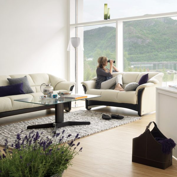 Ekornes® Oslo Sofa in Paloma Light Grey and Wenge Wood, A Lady looking out the Window