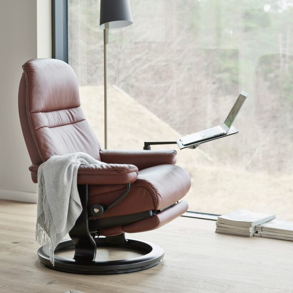 Stressless Classic Recliner with attached Stressless Computer Table and Laptop in Window